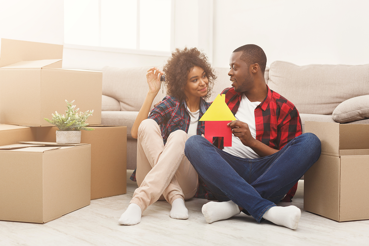 couple sitting on floor at new apartment